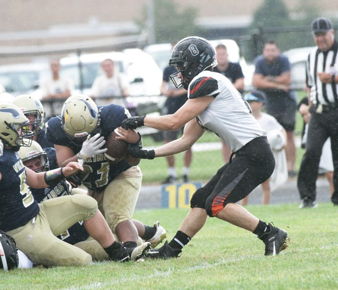 Sturgis' Breckin Prichard forces a fumble against Niles during Wolverine Conference action on Thursday evening.