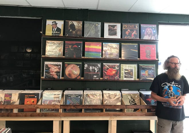 Steve Levine, one of three partners who reopened School Kids Records on Kerr Avenue in Wilmington on Aug. 19, just a few doors down from where it closed in early 2003.