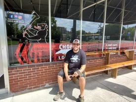 George Bessey is pictured at the new location of his business, Beary The Hatchet Axe Throwing Co.
