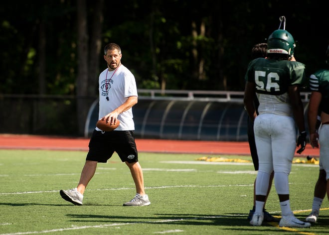 Fitchburg State football head coach Scott Sperone and the Falcons fell in the season opener on Saturday.
