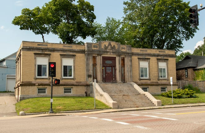 After more than seven decades as a branch library, this building is now divided into two condominiums.