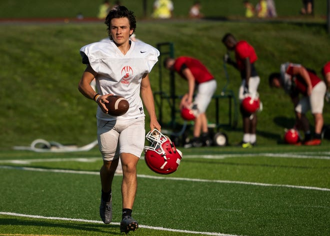 St. John's kicker Sam Lavallee is always on the move during football practice.