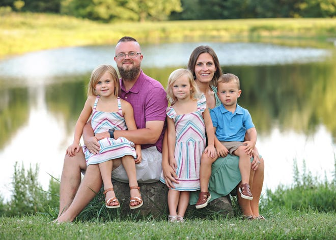 The Derek and Andrea Booth family includes: Front Aubree (left), Ainslee and Derringer. Back: Derek and Andrea Booth.