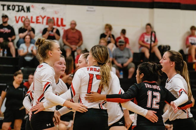 Tusky Valley celebrates a point against Conotton Valley Thursday, August 26.