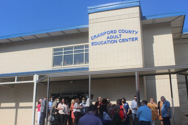 Community members gather outside to celebrate the opening of the new Crawford County Adult Education Center.