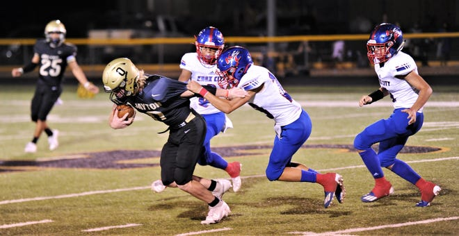 Jayton's Carson Sessums (0) 0tries to elude a Knox City defender in the first half.
