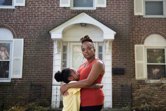 Tiffany Johnson with daughter Victoria, 8, outside their home in Delaware County, Pa.