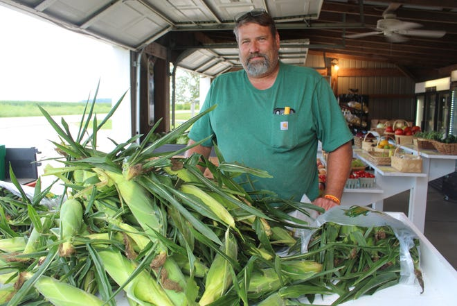 """Chad Overmyer, co-owner of T-Jay's Produce on Napoleon Road, says business is good this year at his farmers market, but nothing like 2020 when customers were """"buying anything they could get their hands on"""" due to fears about the COVID-19 pandemic."""