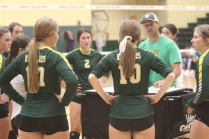C.M. Russell volleyball coach Patrick Hiller talks with his players between sets of an intra-squad scrimmage at the Russell Fieldhouse.
