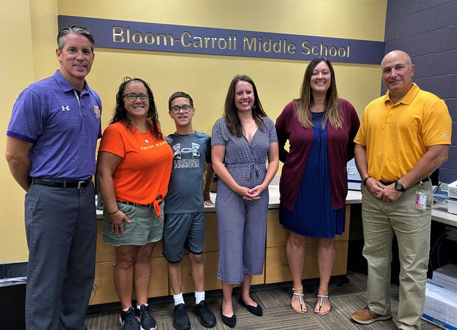 From left to right: Bloom-Carroll Local School District Superintendent Shawn Haughn, Jodi Nyahay, Connor Nyahay, Michelle Newman, Amber Harris, and Bloom-Carroll Middle School Principal Chad Young. Harris won the Ohio Department of Education District 9 2022 Teacher of the Year award after she was nominated by Jodi.