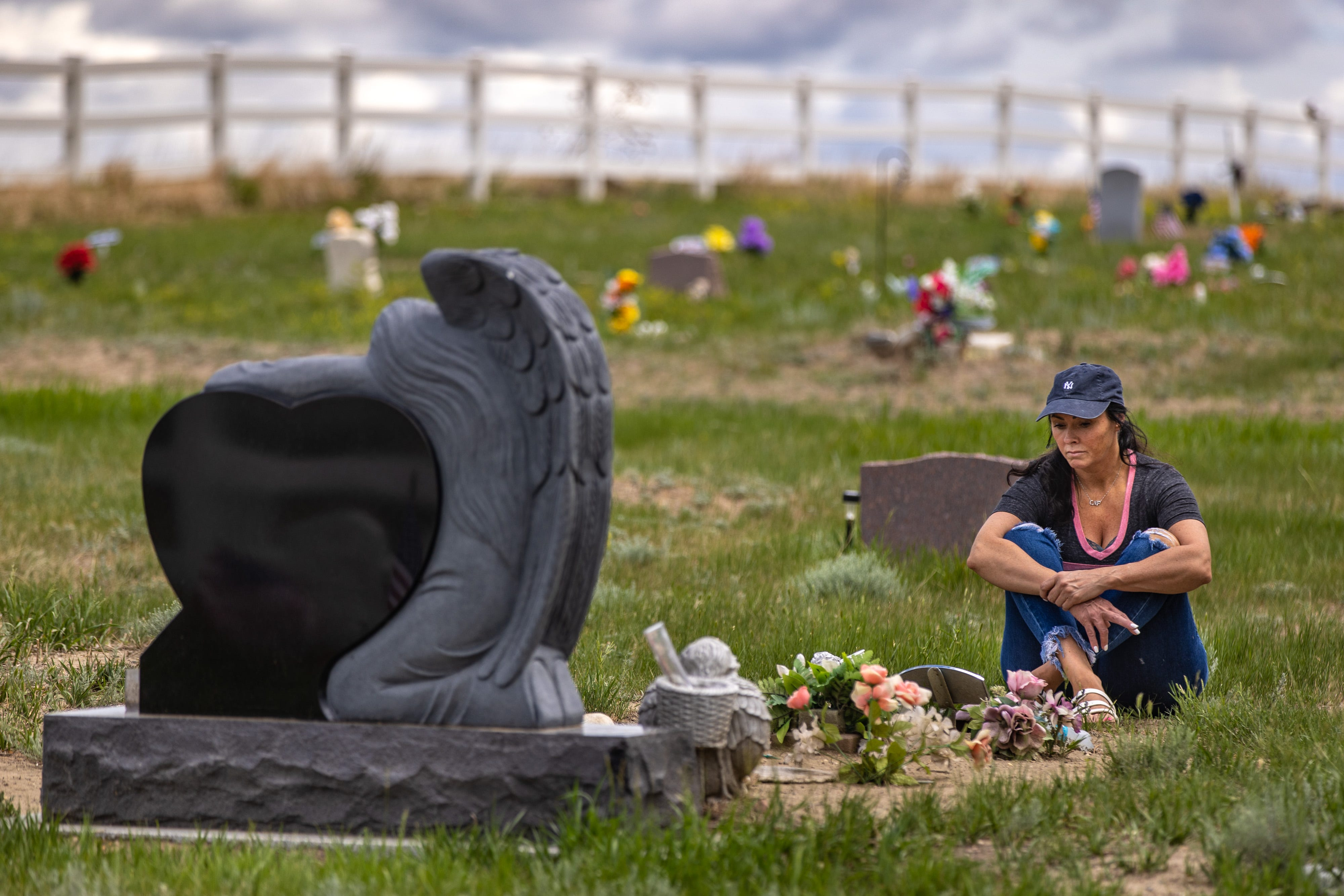 Rhonda Packineau visits the grave of her daughter, Cheyenne, in the Parshall, N.D., Meadows Cemetery. The 21-year-old died of a drug overdose in a Bismarck hotel room in 2018.