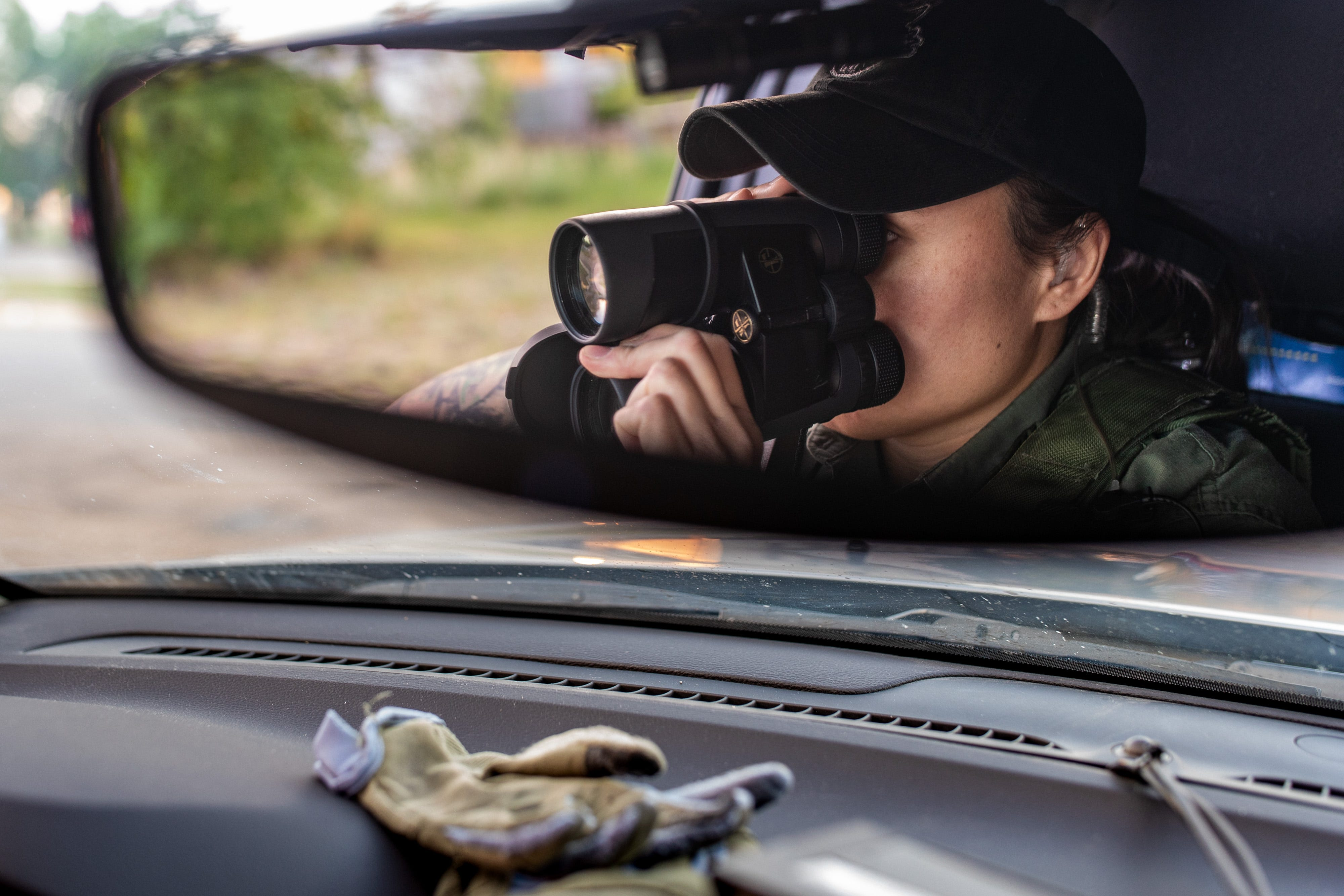 MHA Drug Enforcement patrol agent and K9 handler, Britney Larvie, watches for suspicious activity while on patrol in Parshall, North Dakota. June 25, 2021