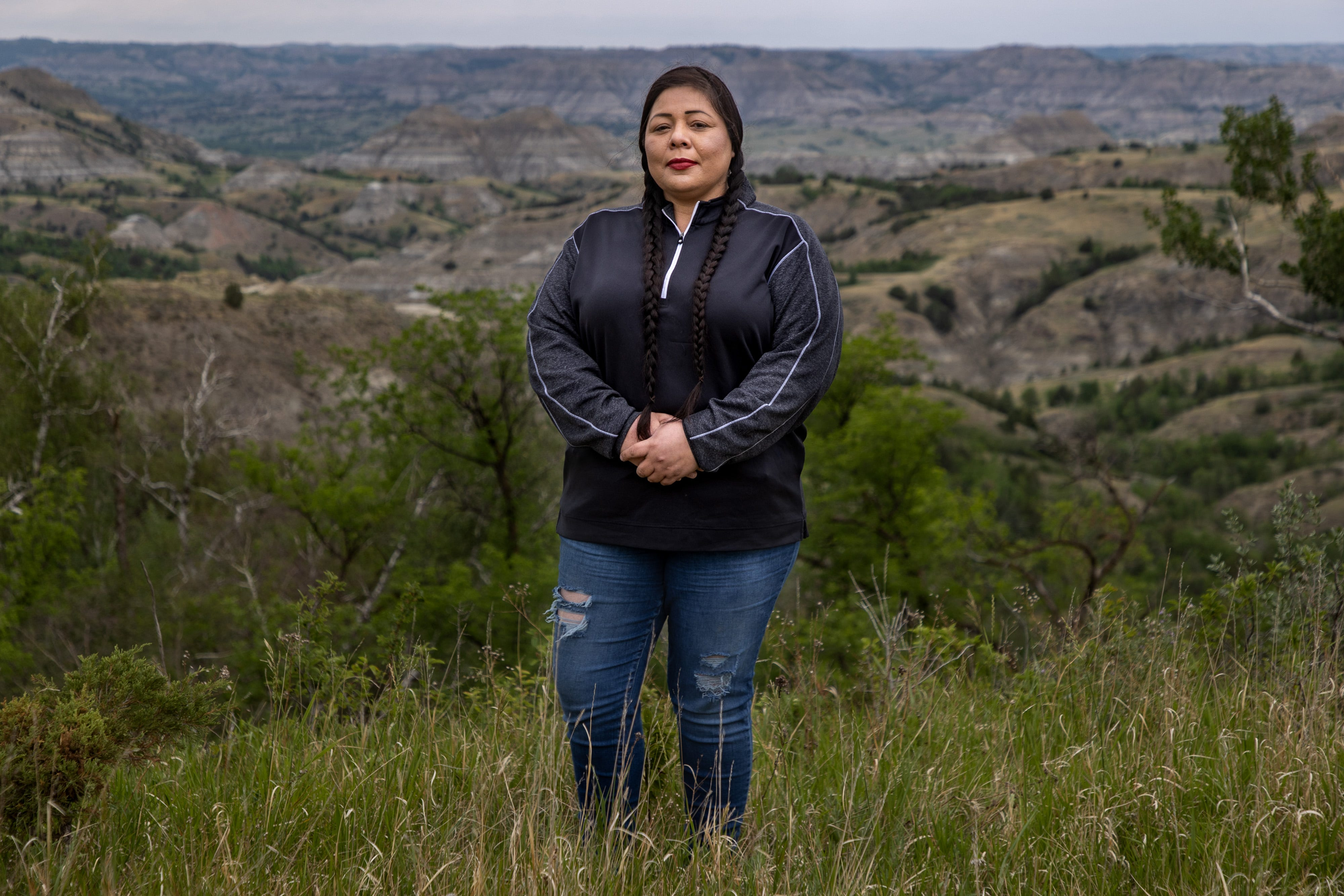 MHA Drug Enforcement special agent Dawn White stands in front of one of her favorite parts of North Dakota, the Badlands area south of the Fort Berthold Reservation. White is an Army veteran who grew up on the reservation and worked as a sergeant for the Tribal Police before joining the specialized drug task force based in Parshall, N.D.