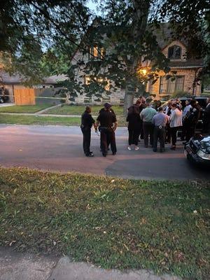Milwaukee police investigators gathered Thursday evening near the scene of an incident in the Sherman Park neighborhood.
