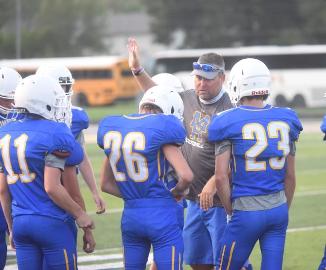 Junior Bomber coach Greg Crow talks with his team during the preseason game against Batesville.