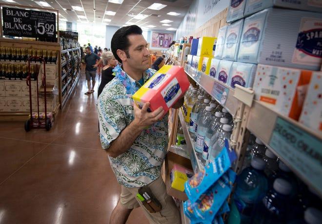 Trader Joe's Crew Member Jeff Carter restocks the shelves at the new Trader Joe's store Friday, Aug. 27, 2021 in Franklin, Tenn.