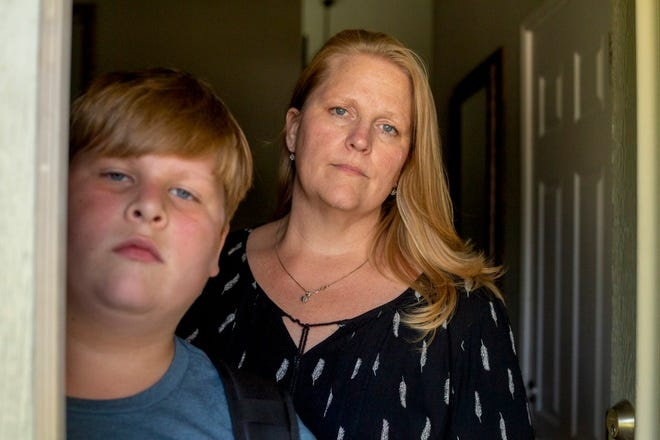 Kayden Christiansen and his mother, Heather Christiansen, at their home in Simi Valley. Kayden, a fifth-grader, was in quarantine for 10 days shortly after his California school reopening.