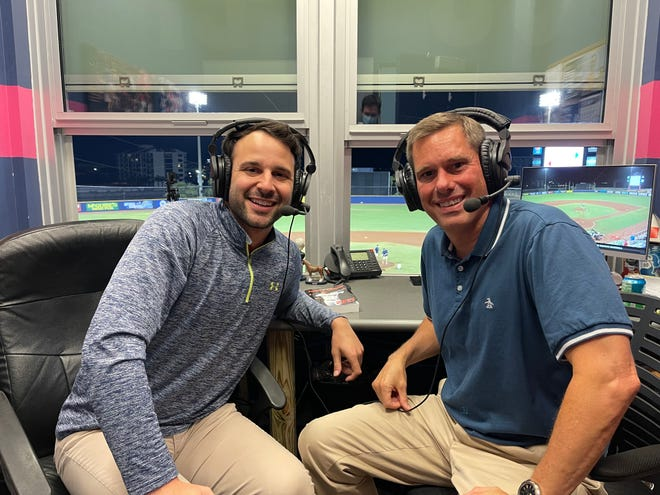 Blue Wahoos radio voice Chris Garagiola, left, joined with Todd Thompson, president of Greater Pensacola Chamber of Commerce, to work recent Blue Wahoos and fulfill Thompson's wish to be broadcaster for a day.