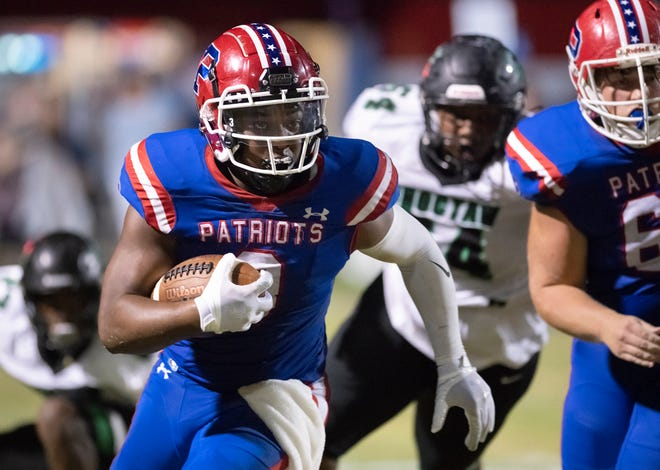 TJ Haynes (3) carries the ball during the Choctaw vs Pace football game at Pace High School in Pace on Thursday, August 26, 2021.