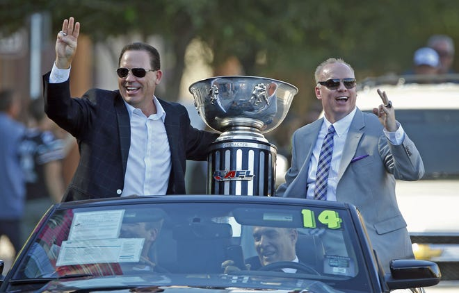 Arizona Rattlers Owner Ron Shurts and Head Coach Kevin Guy take part in their victory parade Wednesday, Aug. 27,  2014 in Phoenix,  Ariz.  The 2014 ArenaBowl Champions Arizona Rattlers beat the Cleveland Gladiator to win Arena Bowl XXVII, 72-32.