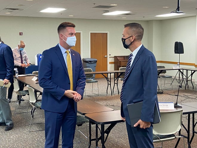 Douglas Huntsinger, the state's executive director for drug prevention, treatment and enforcement, speaks with Kory George, the chief probation officer for Wayne County, following a Tuesday, Aug. 24, 2021, roundtable at Richmond State Hospital.