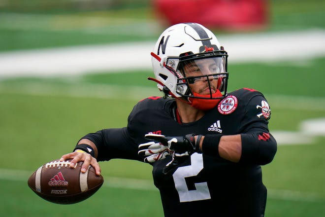 Nebraska quarterback Adrian Martinez (2) warms up before an NCAA college football game against Illinois in Lincoln, Neb., in this Saturday, Nov. 21, 2020, file photo. Adrian Martinez has been through a lot of losing, his body has taken a beating and he's dealt with the frustration of not being able to recapture the form that made him one of the nation's top freshman quarterbacks in 2018. He goes into his fourth season as Nebraska's starting quarterback planning to let it all hang out.