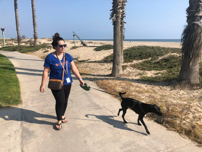 Danielle Gamez, 38, walks Bruce along Hueneme Beach. Gamez said she supports Gov. Gavin Newsom and will vote no in the Sept. 14 recall. Newsom has done his best in a challenging time, she said.