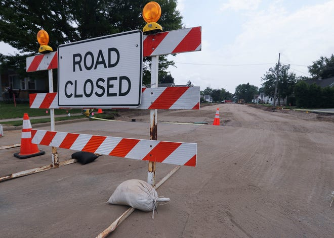 A sign blocks off the street as construction crews work in  July  2021 on the 100 block of 18th Avenue in Wisconsin Rapids. Residents in the neighborhood were charged special assessments to help pay for the roadwork.