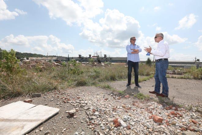 US Representative Tim Ryan, D-Ohio, talks with Zanesville Mayor Don Mason at the former Lear property on Linden Avenue in Zanesville.