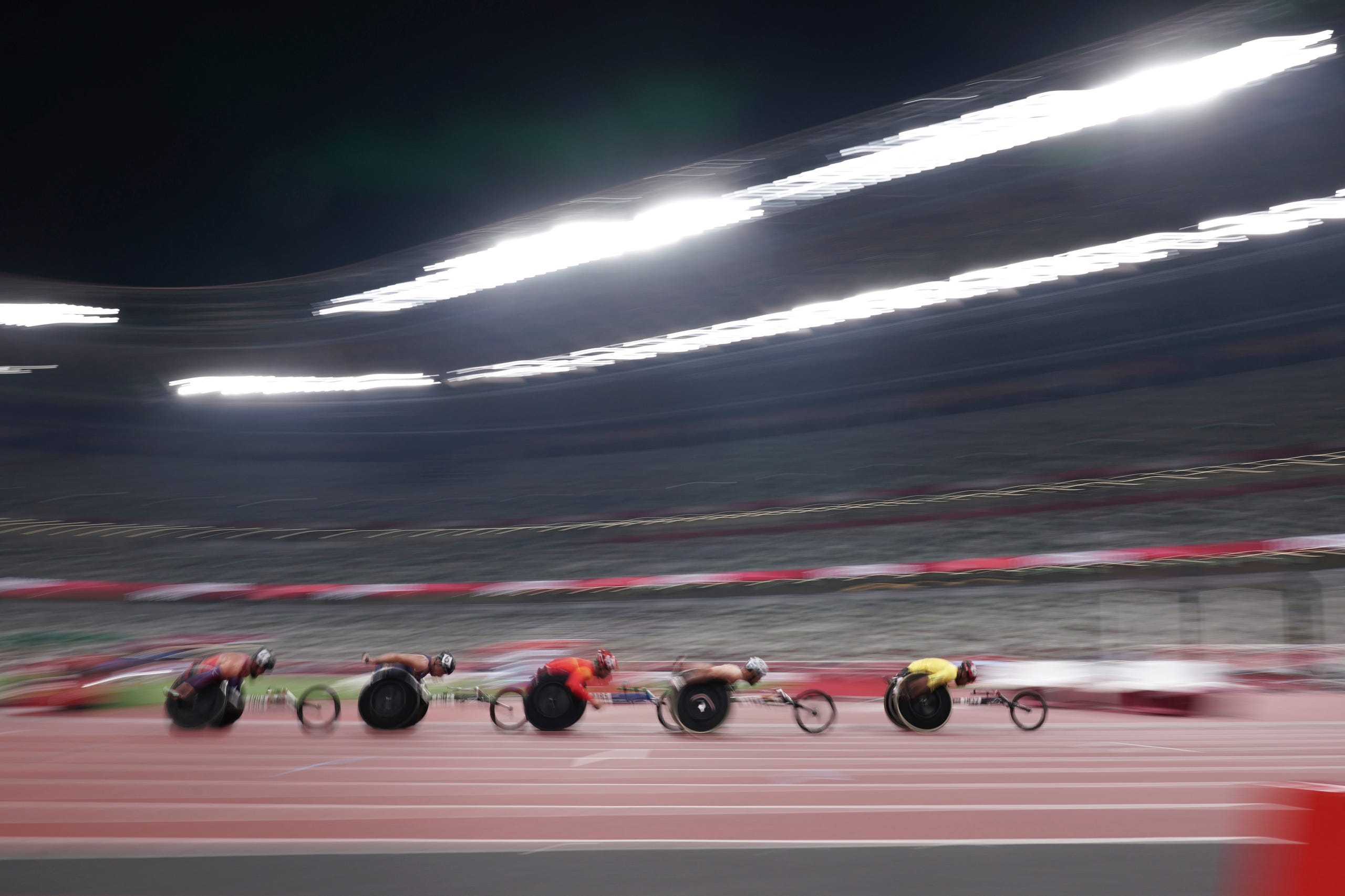 August 27, 2021: Athletes compete during men's T54 5000m heat at Tokyo 2020 Paralympic Games in Tokyo, Japan.