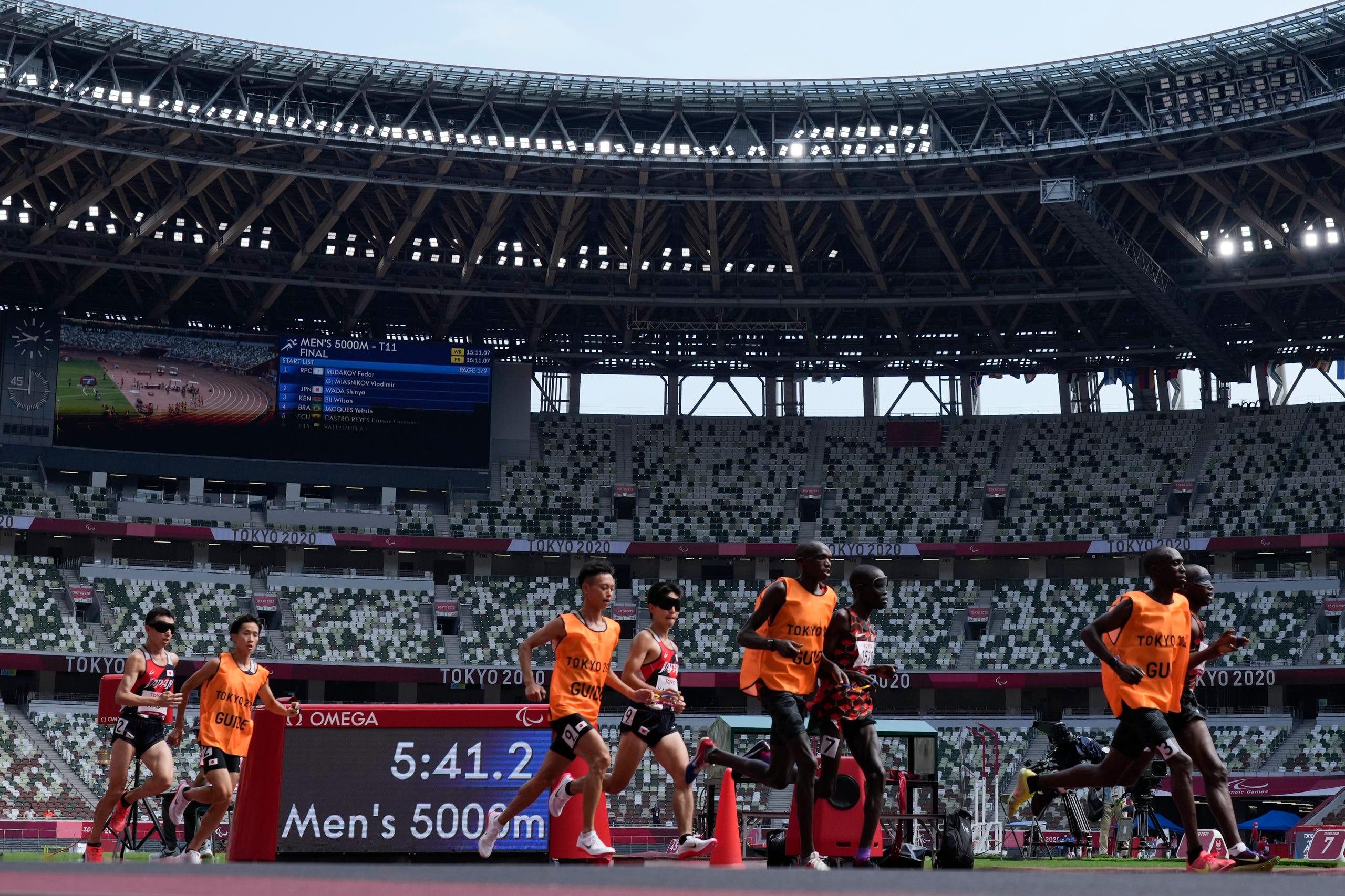 August 27, 2021: Rodgers Kiprop (third from right) of Kenya and Kenya Karasawa (center) of Japan compete during the men's 5000-meter run.