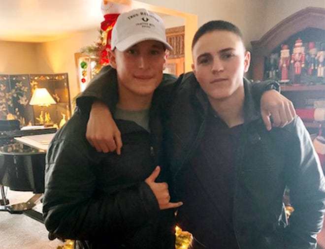 Rylee McCollum, right, poses with Eli Stone in December 2019 at Stone's House in Jackson, Wyo. McCollum was killed in Kabul on Aug. 26, 2021.