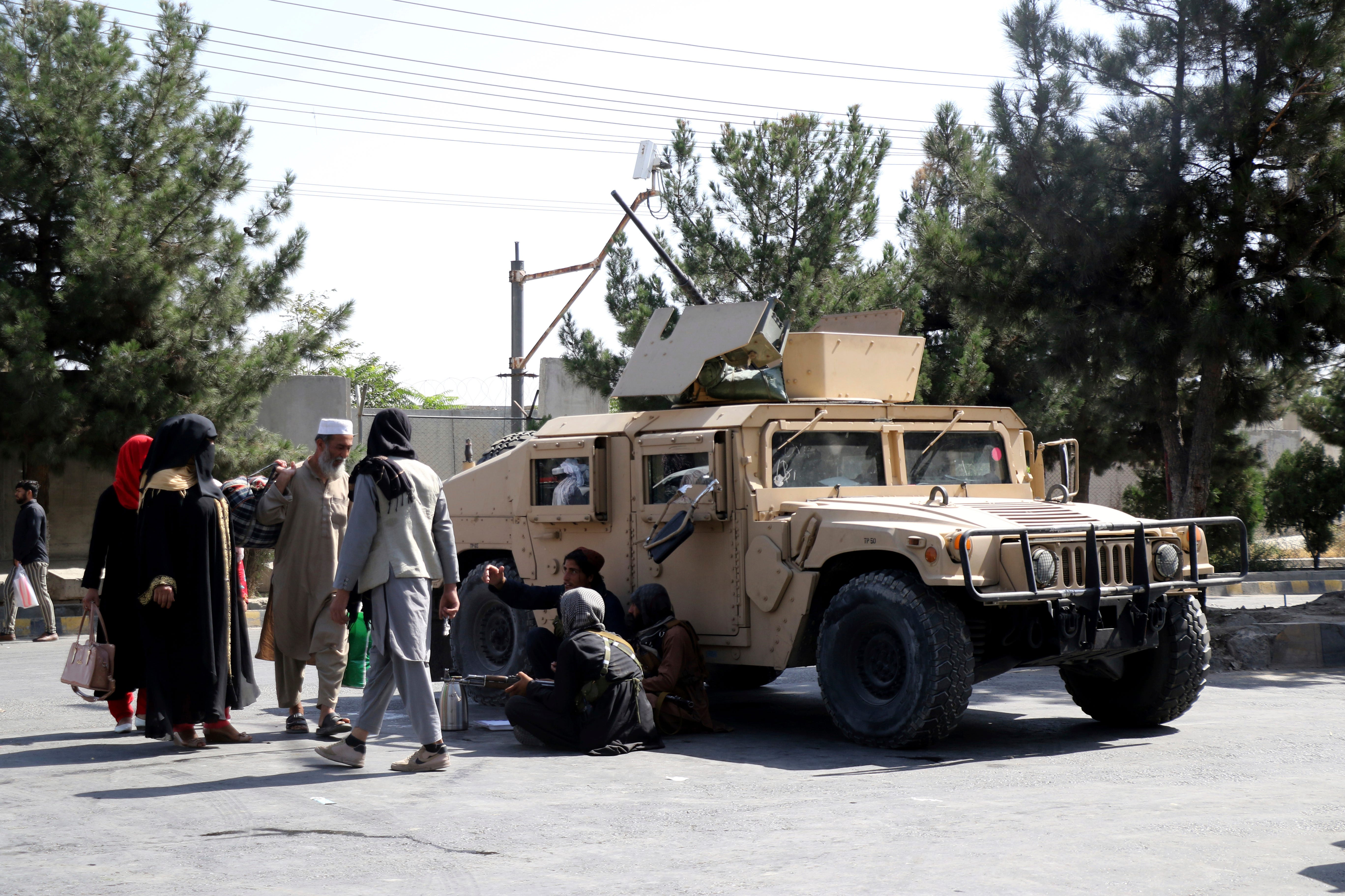 Afghanistan live updates: US warns Americans to leave Kabul airport  immediately ; Biden says another Kabul attack  highly likely