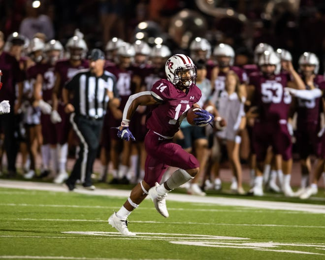 Round Rock running back Trayvian MccCoy-Gay races down the field for a Round Rock touchdown. MccCoy-Gay had 245 of Round Rock's 520 yards rushing as the Dragons won their home football opener, a nondistrict game with Waco Midway, 69-17 on Aug. 27 at Dragon Stadium.