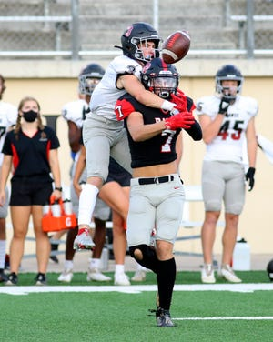 Bowie defensive back Tanner Galow goes over Vista Ridge wideout Wyatt Gates to break up a first-quarter pass Friday in the Bulldogs' 17-7 win over the Rangers.