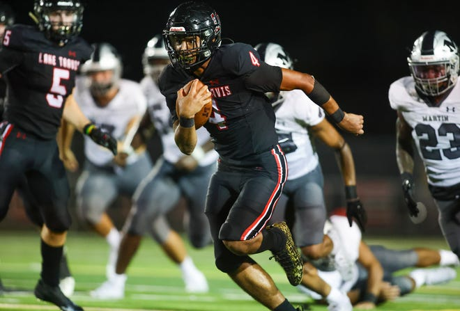 Lake Travis running back Derrick Johnson breaks loose for a long touchdown run against Arlington Martin in Friday's game at Cavalier Stadium. The Cavaliers opened the season with a 40-28 win over Martin.
