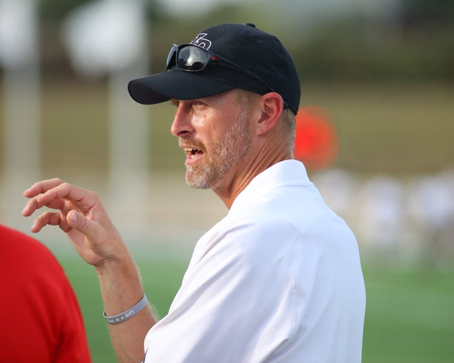 Vista Ridge head coach Chad Scott prior to the start of the season opening game against the Bowie Bulldogs on Aug. 27 at Gupton Stadium.