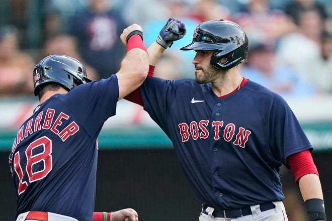 Boston Red Sox designated hitter J.D. Martinez, right, celebrates with Kyle Schwarber after hitting a three-run home run in the 10th inning of a 5-3 win over Cleveland on Saturday at Progressive Field. [Tony Dejak/Associated Press]