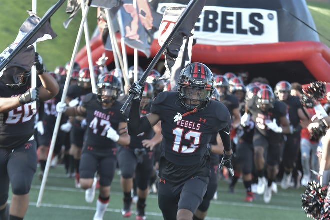 Ke'Mauri Pinkard (13) leads the Tascosa football team on to the field before a nondistrict game Friday, Aug. 28, 2021 against Abilene High at Dick Bivins Stadium in Amarillo.