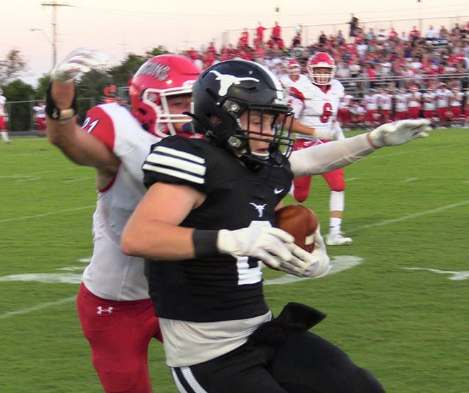 Lone Grove senior Blayde Wilkerson makes a move as a Purcell defender closes in Friday night. Wilkerson and the Longhorns jumped out to an early lead en route to a 40-7 win.