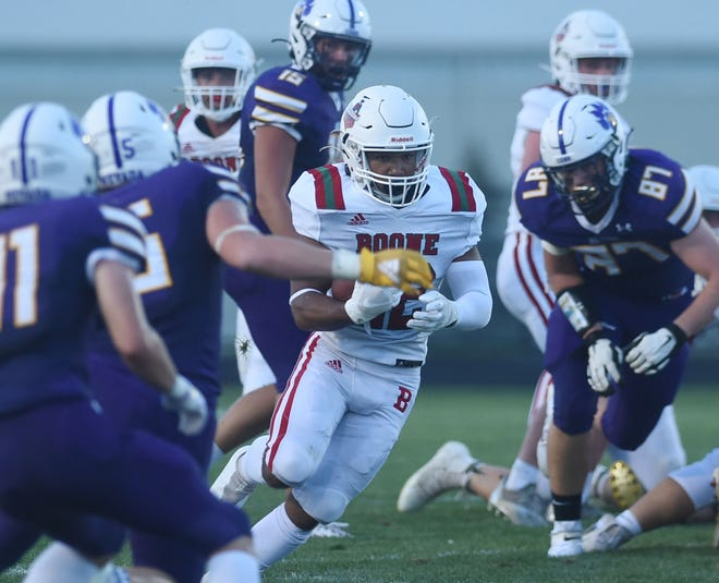 Boone's running back Landon Davis runs with the ball for a first down against Nevada during the first quarter at Nevada High School Friday, August 27, 2021, in Nevada, Iowa.