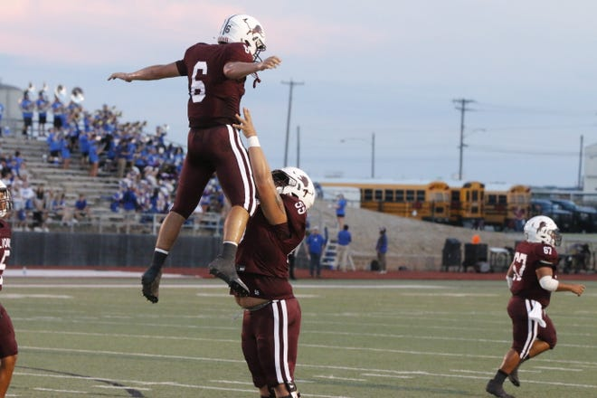 Brownwood Lions junior quarterback Chance Jones leaps in the air as he celebrates with teammates after running for a touchdown in the first quarter against Lampasas on Friday night at Gordon Wood Stadium.