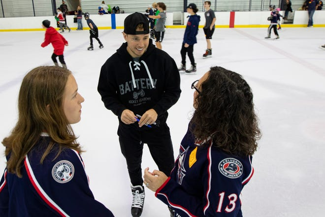 """Cam Atkinson, recently traded by the Blue Jackets to Philadelphia, talks with Michele (right) and Natalie Holdren during the """"Skate With Cam"""" charity event Saturday at the OhioHealth Ice Haus. Atkinson vows to remain active with his local community service. """"We love Columbus,"""" he said. """"Columbus is home and we want to continue that."""""""