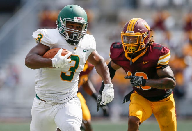 Kentucky State Thorobreds running back Brett Sylve (3) rushes past Central State Marauders defensive back Bryan Sarente (13) during the first quarter of the HBCU Classic For Columbus football game at Ohio Stadium on Saturday, Aug. 28, 2021.
