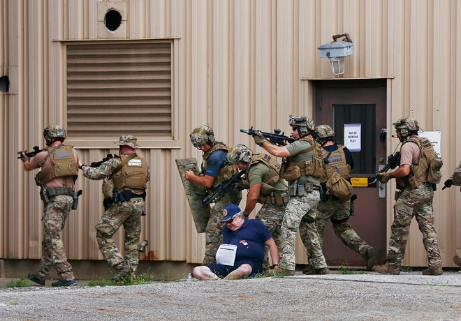 The Franklin County Complex Coordinated Terrorist Attack Full-Scale Exercise was held Saturday. Seven simulated terrorist attacks were held at different central Ohio locations as part of training for law enforcement and other emergency responders. At Anheuser-Busch Brewery on the North Side, Columbus SWAT officers search for terrorists during the exercise. They are passing one of the actors portraying a victim.