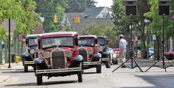 Ford Model A's and other classic and antique cars roll into Adrian during the Back to the Bricks promotional car tour on June 13, 2017. Adrian is applying to be a stop on the 2022 tour.