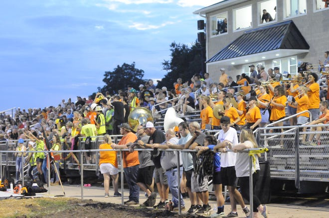 High school football season opened Thursday with fans in the stands without pandemic restrictions for the first time since the 2019 season. Hudson fans filled Thompson Field Thursday to watch the Tigers defeat Ithaca, 59-14.