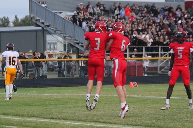 Drew Hofstad celebrates with a teammate following a touchdown.
