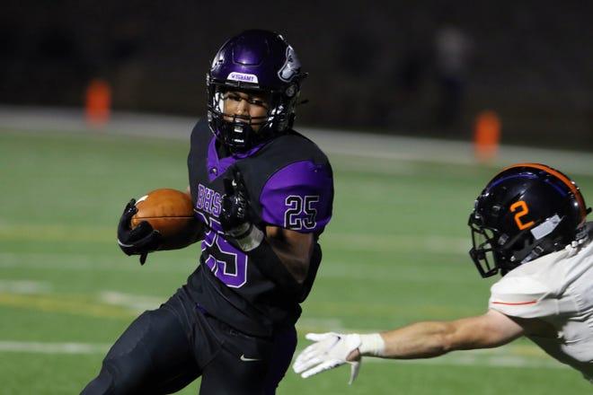 Burlington High School's Bryant Williams (25) evades Jacob Miller (2) during their season home opener against Washington High School Friday Aug. 27, 2021, at Burlington's Bracewell Stadium.