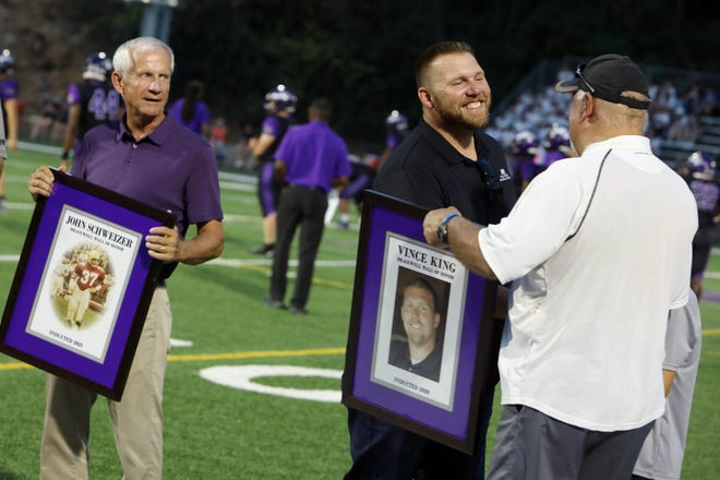 Vince King who played for the Grayhounds is inducted along with Bill Bailey, Edsel Schweizer, Mel Knotts, Ted Sherwood, and John Schweizer into the Bracewell Wall of Honor before the start of Burlington High School's season home opener against Washington High SchoolFriday Aug. 27, 2021, at Bracewell Stadium.